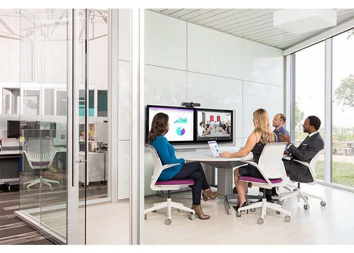 Logitech-MeetUp-ConferenceCam-lifestyle-huddle-small-meeting-room-camera-above-display